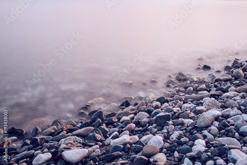 Photographie  Dreamy natural background with sea shore, rocks and waves