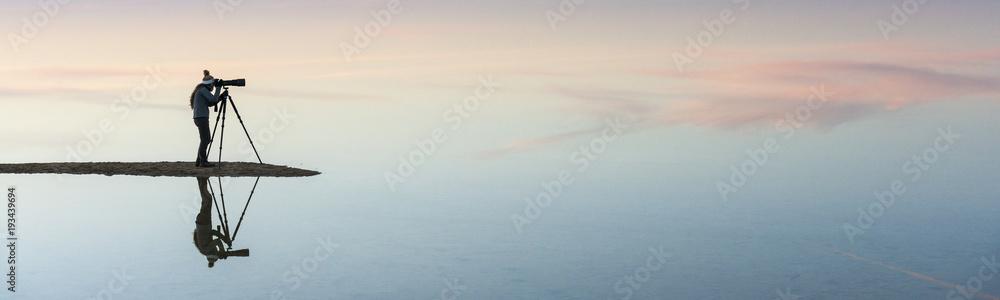 Fototapeta Silhouette and reflection of photographer in Bahariya salt lake - obraz na płótnie