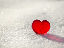 Red Heart On A White Snow.