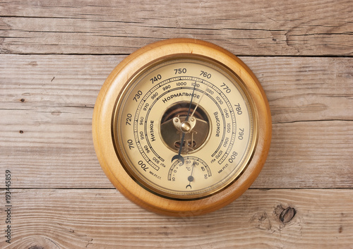 aneroid barometer on a wooden wall Wallpaper Mural