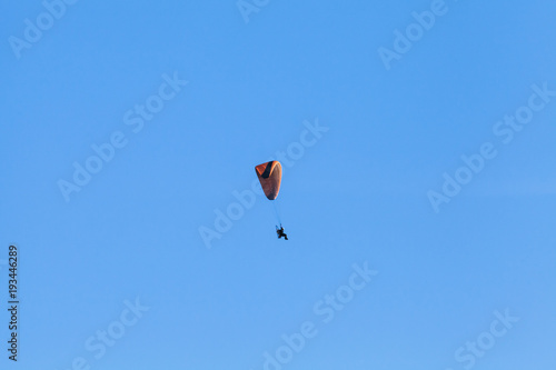 Paraglider in blue sky, ultralight aircraft
