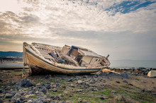Shipwreck At The Coastline Of A Small Cretan Fishing Village. Once Upon The Time It Was Sailing To The Aegean Sea.