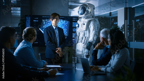 Obraz na plátně  In the Conference Room of the Center of Technology Chief Engineer Presents Next Generation Space Suit to a Board of Directors