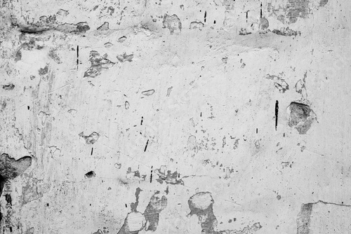 Poster Betonbehang Wall fragment with scratches and cracks