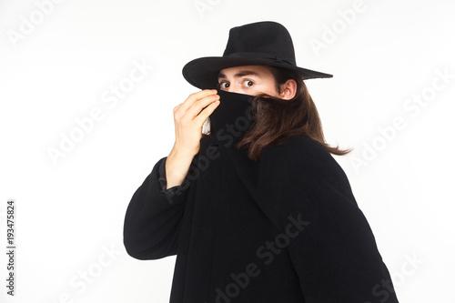 Fotografía  Incognito secrecy agent spy, looking at camera with big eyes