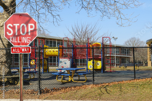 Fényképezés  Ominous Stop Killing Sign at Grammar School