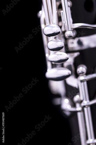 A new silver plated clarinet on a black background Tableau sur Toile