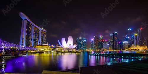 Singapore skyline with urban buildings over water Poster