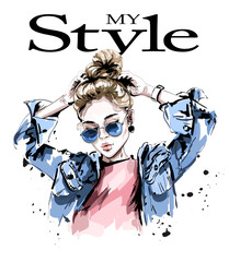 Naklejka Fashion woman in jeans jacket. Stylish beautiful young woman in sunglasses. Sketch.