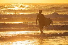 A Surfer Heading Out