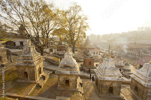 Stupas and cremation smoke at Pashupatinath Hindu temple in Nepal