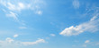 Light clouds in the blue sky. Wide photo