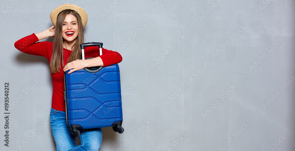 Fototapety, obrazy: Smiling happy woman with travel suitcase.