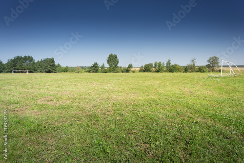 Fotografie, Obraz  Soccer field with blue sky in the countryside.