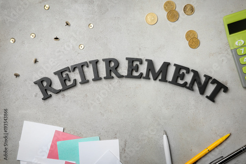 word retirement on grey background pension planning buy this