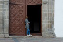 Woman In The Door Of The Paris...