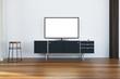 TV set on a black cabinet in living room