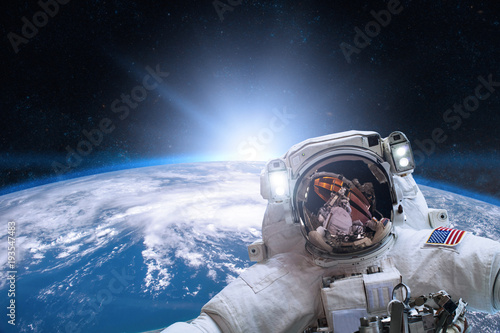 Deurstickers Nasa Astronaut in outer space on background of the Earth. Elements of this image furnished by NASA.