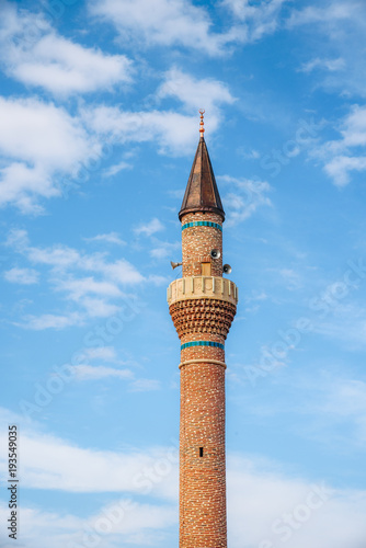 Minaret of a mosque in Turkey and blue sky background Fototapeta