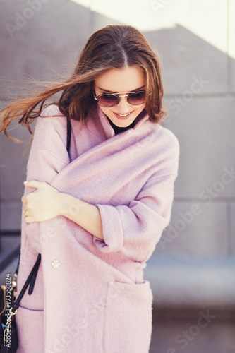 Fotografie, Obraz  young fashion woman beauty portrait posing in city wearing coat and sunglasses