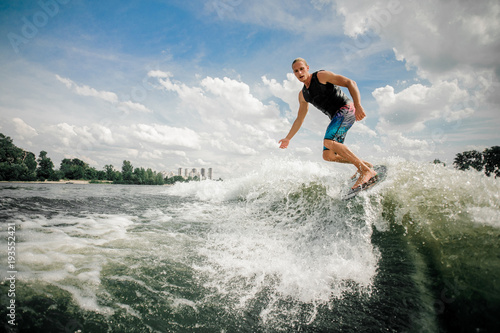 Fotografie, Obraz  athletic rider cuts rapidly in toward the wake