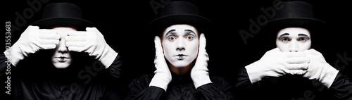 Fotografie, Tablou  mime showing see no evil, hear no evil, speak no evil isolated on black