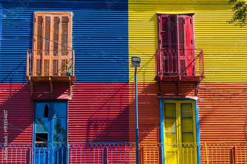 Spoed Foto op Canvas Buenos Aires Colorful area in La Boca neighborhoods in Buenos Aires. Street is a major tourist attraction & the area is filled with colorfully painted buildings.