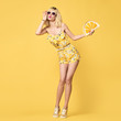 Fashionable Blond model with Kiss Face, Trendy Sunglasses. Stylish Glamour fashion woman Having Fun in Summer Yellow Outfit. Young Beautiful European Hipster girl Posing in Studio