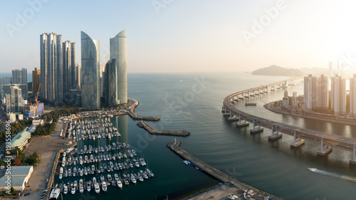 Panorama of Busan city skyline view at Haeundae district, Gwangalli Beach with yacht pier at Busan, South Korea Canvas Print