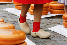 Young Woman Legs In Wooden Dutch Klomp Shoes On A Old Town Market In Gouda, Holland