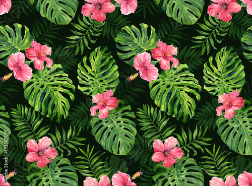 Seamless pattern with monstera and palm leaves on dark background.Tropical camouflage print.