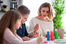 Loving Family Mother With Children Together Paint At Home