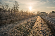 Road And Roadside With A Ditch During A Frosty Morning