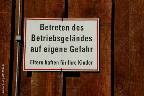 German Sign Enter the premises at your own risk , Schild in einem Betriebsgelä Wallpaper Mural