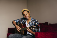 Cheerful Ethnic Man With Guitar