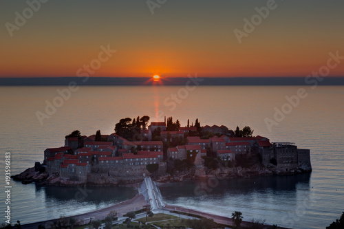 Photo Sveti Stefan island in Budva in sunset, Montenegro