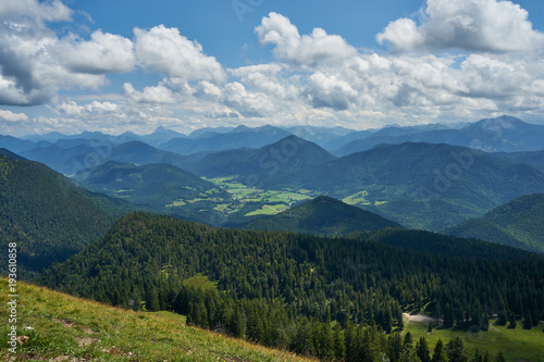 panoramic view at the bavarian alpes mountains with Jachenau under deep blue sky with white clouds #193610858