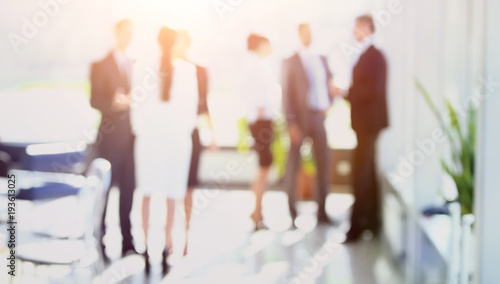 blurred image of business people standing in office.business bac