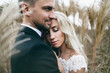 Close-up portrait of Newlyweds in love in nature. Wedding