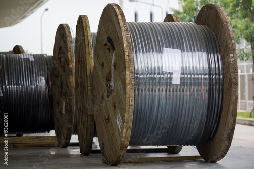 Rolls of high-voltage power cable on floor Fototapet