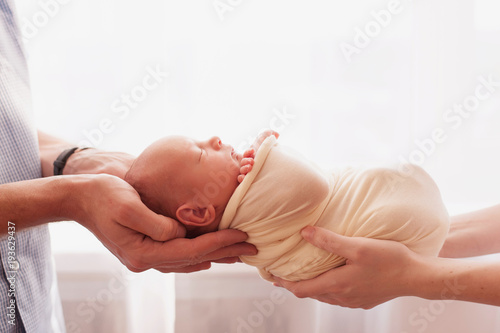 newborn baby in  hands