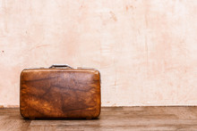 Vintage Brown Traveling Luggage On Wall Background. Travel Suitcases Concept