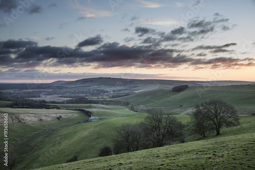 Spoed Foto op Canvas Khaki Stunning vibrant sunrise landscape image over English countryside landscape with lovely light hitting the hills