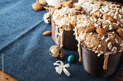 Colomba - italian easter dove cake on old rustic cyan wooden board. Selective focus, free text space.