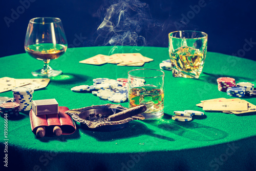 Gambling green table with chips and cards плакат