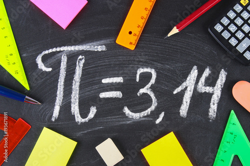 The mathematical sign or symbol for Pi on a blackboard.