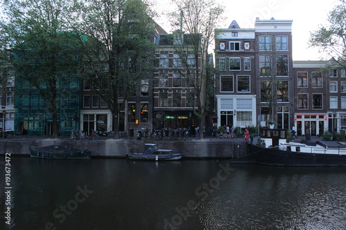 Photo  Amsterdam cannal with boats and houses