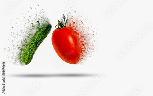 Tomato and cucumber exploding (dispersing) on white background Wallpaper Mural