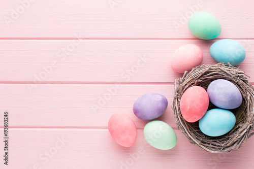 Stampa su Tela  Pastel Easter eggs background. Spring greating card.