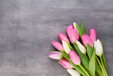 Fototapeta Tulipany - Mother's Day, woman's day, easter, pink tulips, presents on gray  background.